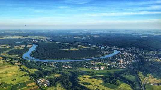 An_aerial_photo_of_the_town_of_Prienai_and_river_Nemunas_from_a_hot-air_balloon.